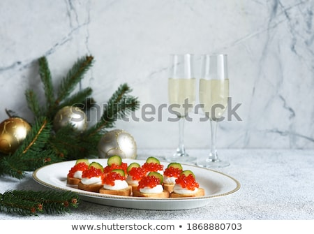 toasts with red salmon caviar and champagne stock photo © furmanphoto