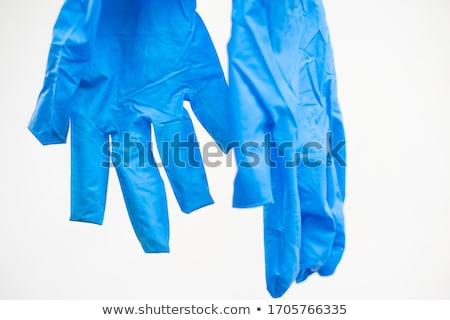 surgeon putting medical gloves on Stock photo © vladacanon