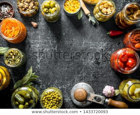 Ogórki pozostawia czosnku zachowane żywności plakat Zdjęcia stock © robuart