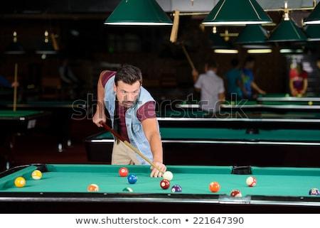 Adam oynama snooker karanlık kulüp spor Stok fotoğraf © Lopolo