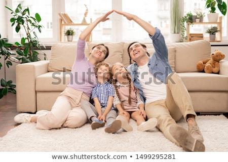 Stok fotoğraf: Genç · ebeveyn · eller · yakın · çatı · iki