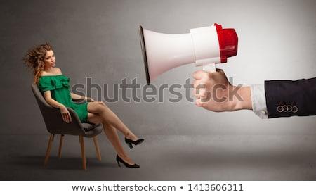 Elegancki model posiedzenia naprzeciwko duży głośnik Zdjęcia stock © ra2studio