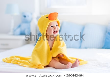 A Baby boy playing on the parent bed Stock photo © Lopolo
