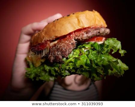Teen girl eats a huge hamburger Stock photo © AndreyKr