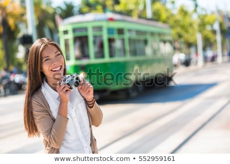 San Francisco cable car tramway woman tourist taking pictures of popular attraction vintage tram by  Stock photo © Maridav