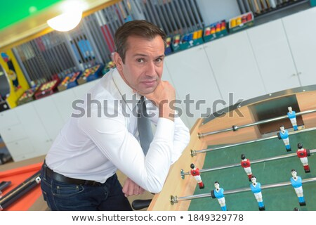 Man plays into table football in store Stock photo © Paha_L