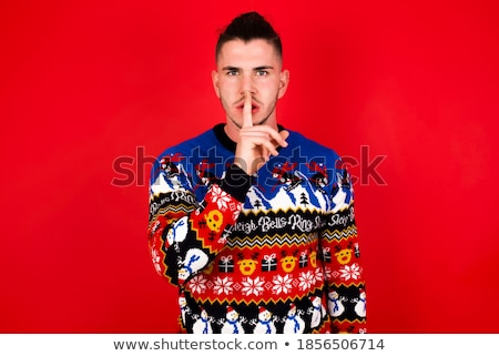 Young man in red sweater makes gesture by finger stock photo © Paha_L