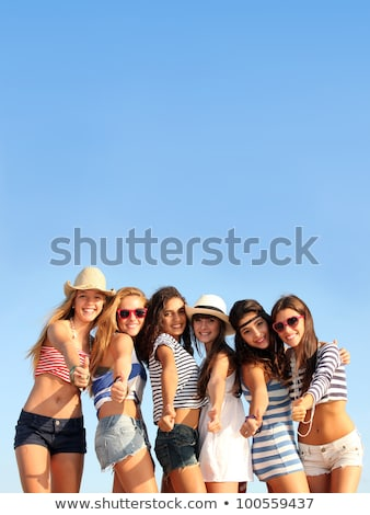 mixed race group of teens on summer vacation or spring break holiday stock photo © godfer