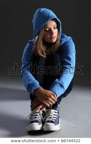 Blonde teenager girl alone and sad in blue hoodie Stock photo © darrinhenry
