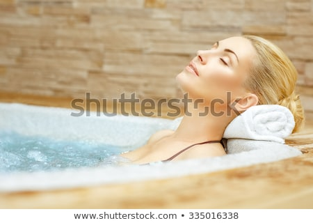 Stock photo: woman relaxing in jacuzzi