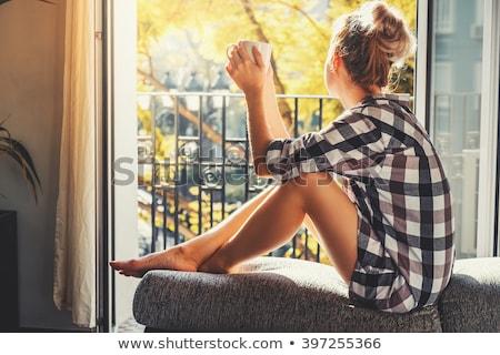 jonge · vrouw · thee · fauteuil · sluiten - stockfoto © hasloo