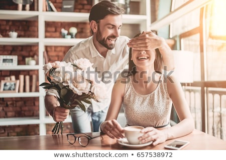 couple in love with flowers stock photo © dolgachov