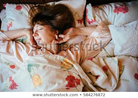 Woman slowly waking up Stock photo © photography33