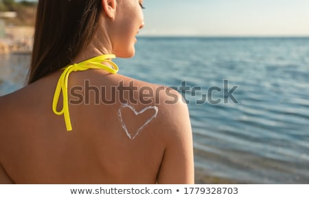 nő · napozás · fehér · bikini · lesülés · testápoló - stock fotó © RTimages