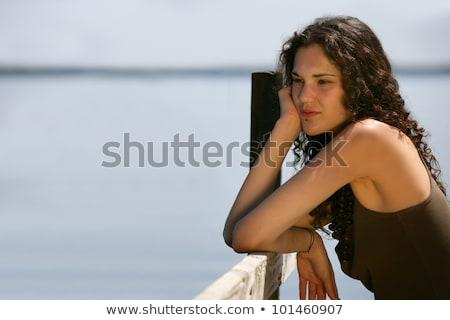 Brunette stood on jetty alone Stock photo © photography33