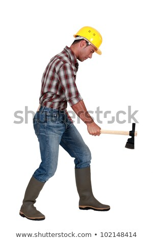Tradesman using an axe to cut wood Stock photo © photography33