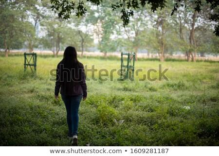 Asian indian woman walking in golden dried field Stock photo © lunamarina