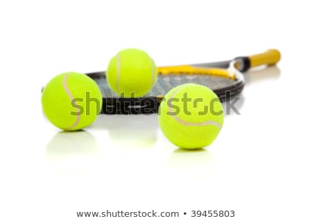 three tennis ball on a racket strings in the background stock photo © mnsanthoshkumar