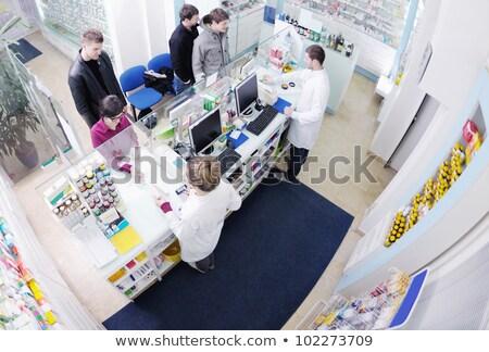 pharmacist suggesting medical drug to buyer in pharmacy drugstore stock photo © dotshock