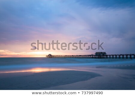 calm ocean during tropical sunrise stock photo © dmitry_rukhlenko
