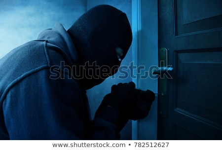 burglar picking door lock stock photo © filmstroem