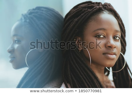 Woman and young girl leaning on glass surface Stock photo © photography33