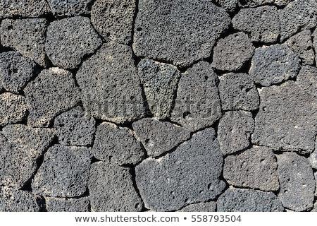 Kamieniarstwo wulkaniczny kamienie ściany tekstury Zdjęcia stock © lunamarina