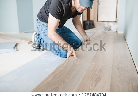 Man laying a hardwood floor Stock photo © photography33
