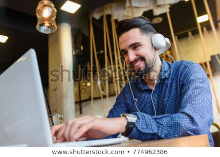 brown-haired man with headphones Stock photo © photography33