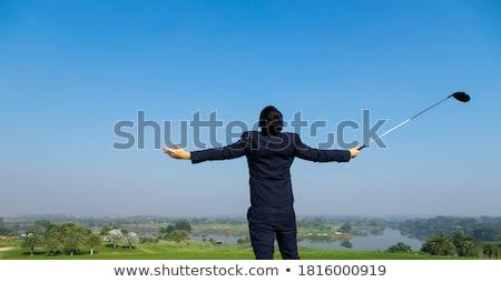Businessman swinging golf club Stock photo © photography33