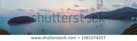 spectacular sunset over promthep cape phuket island thailand stock photo © moses