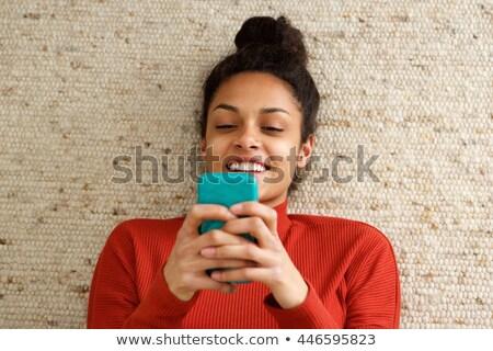 Femme texte étage maison Photo stock © wavebreak_media