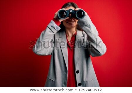 delighted woman using binoculars stock photo © wavebreak_media