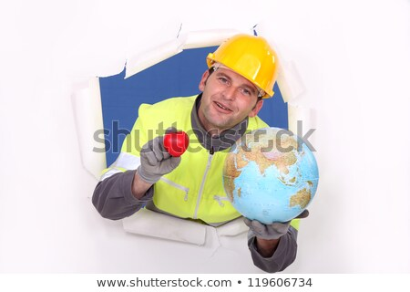 portrait of foreman holding globe Stock photo © photography33