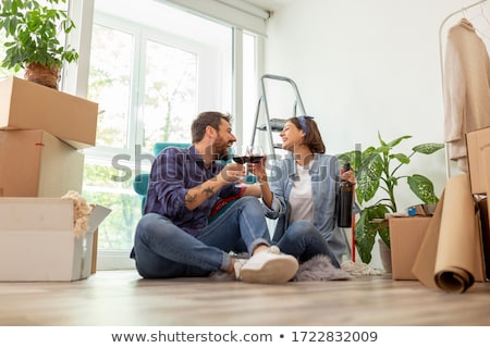 Stock photo: Couple celebrating new house
