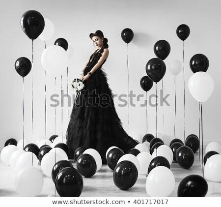 Girl with balloons on the floor Stock photo © kalozzolak