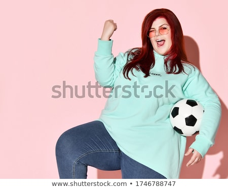 lovely woman with big soccer ball stock photo © dolgachov