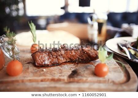 Delicioso carne de vacuno cuchillo mesa de madera alimentos vaca Foto stock © Kesu