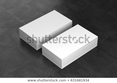 3d businessman in office showing a blank business card stock photo © dacasdo