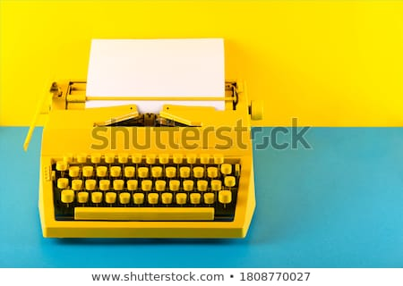 old yellow typewriter with paper Stock photo © pterwort