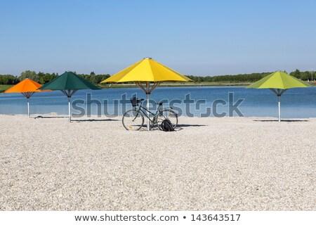 Orange Sun Umbrella On A Bathing Lake In Munich Bavaria Stok fotoğraf © haraldmuc