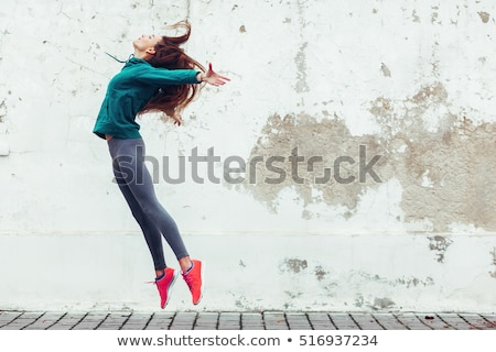 young dancer woman jumping stock photo © stepstock