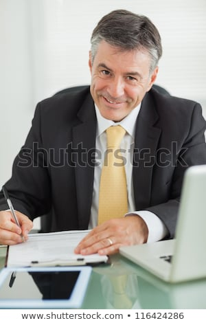 business man writes on his clipboard stock photo © feedough