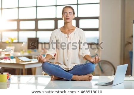 Zakenvrouw yoga zwart pak oefening witte business Stockfoto © w20er