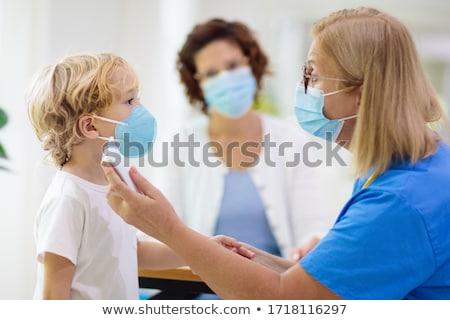 Pediatra doutor sorrir trabalhar criança medicina Foto stock © carbouval