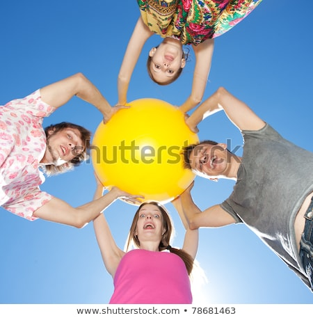 smiling casual man looking into a big ball of light  Stock photo © feedough