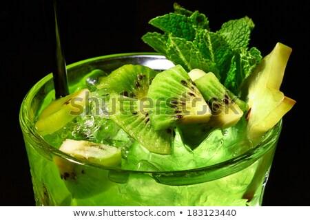 Green refreshing cocktail like mojito on dark background. Close  Stock photo © dariazu