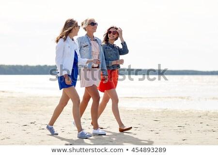 teenagers walking on beach stock photo © monkey_business
