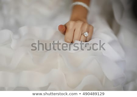bride with wedding or engagement ring Stock photo © dolgachov
