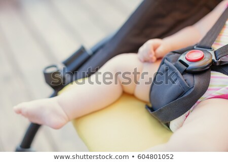 close up of a baby boy in a baby carriage stock photo © bmonteny